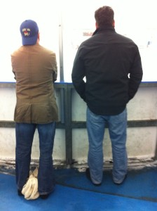 hockey dads watching a game